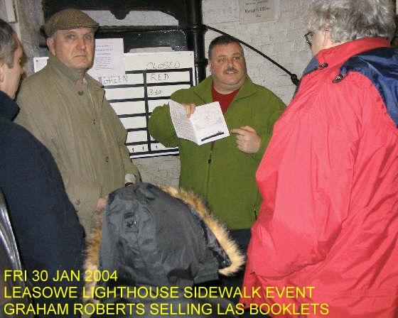 Graham Roberts selling LAS booklets at the Leasowe Lighthouse Sidewalk Astronomy Event, Friday 30th January 2004