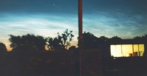 Noctilucent clouds, taken by David Galvin on June 23rd/24th 1995 at 03:30 BST (02:30 UT) 30/40 sec exps, 50mm standard lens at f2 200 ASA colour print film. The bright star is Capella.