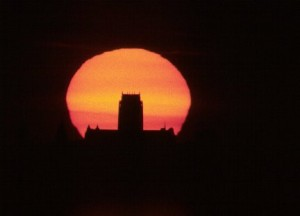The Setting Sun behind the Liverpool's Anglican Cathedral. Photographed from Mersey heights, Frodsham. Taken via prime focus through a Celestron C5 Telescope, f10. Using Agfa 200 slide film, by David Forshaw, May 21st, 1998
