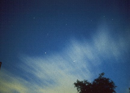 Iridium Flare, taken by David Forshaw at 23:38:35 BST on 28th June, 1998. Iridium 64, Magnitude -6.4, Elevation 42°, Azimuth 257° (W) Taken on AgfaCT200 slide film at f1.4. Taken 2 seconds before and after flare. Average total exposure time 9-10 seconds.