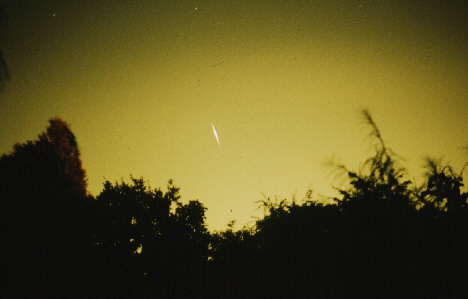 Iridium Flare, taken by Andrew and Val White. 22:08:35 BST on 28th August, 1998. Iridium 60, Magnitude -4, Elevation 12°, Azimuth 355° (N), Image taken on 400ASA Fujichrome slide film at f1.8. 55mm Lens using Pentax MV1 Camera