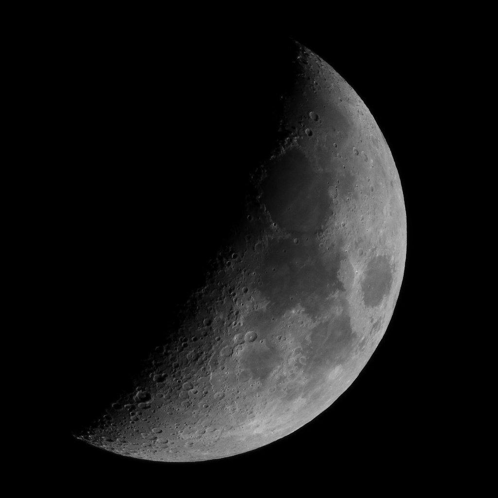 Lunar terminator taken in 2010 by Mark Payne. Stacked 1.4x & 2x Canon teleconverters on a Canon 300mm f/4L IS USM, then cropped