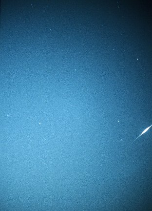 Iridium Flare, taken by David Forshaw at 23:29:37 BST on 1st July, 1998. Iridium 63, Magnitude -6, Elevation 37°, Azimuth 263° (W) Taken on Agfa CT200 slide film at f1.4. Taken 2 seconds before and after flare. Average total exposure time 9-10 seconds.