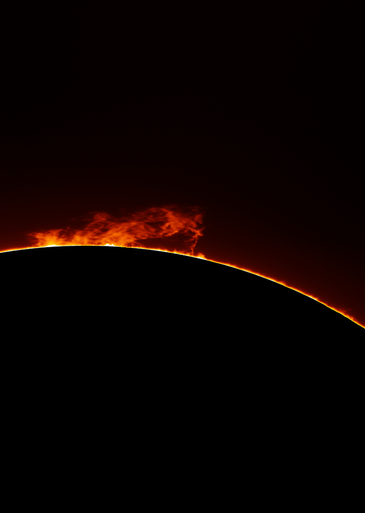 Lifting Prominence, taken by Mark Payne with a 100mm PST modded H-Alpha telescope, 1.6x barlow and DMK31 CCD on 13th May 2013 at 12:36:57