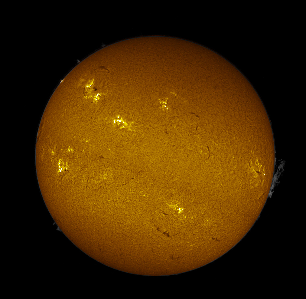 Solar disk, taken by Mark Payne, showing a lifting prominence and at the 10 o'clock position on the limb is a bright spot showing the second of the three x-class flares (X2.8) which occured in the previous 24 hours. This is located at the active region AR1748 which is moving around onto the earth facing side of the solar disc. This image was captured with a double stacked 50mm H-Alpha scope & DMK31 CCD on 13th May 2013 at 13:16:59