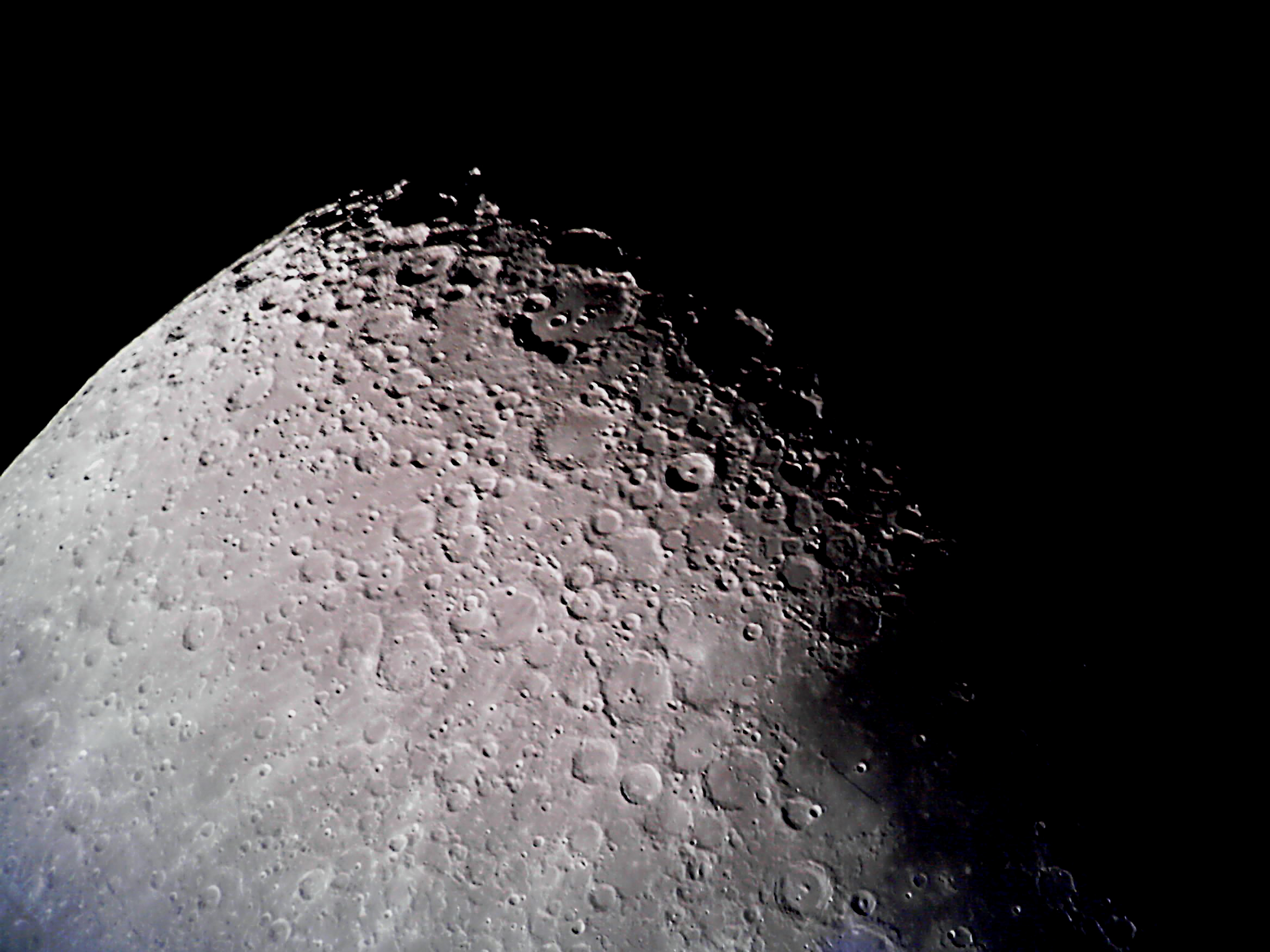 Image of the moon taken by Dave Thomson, during or before December 2006. No other information known.