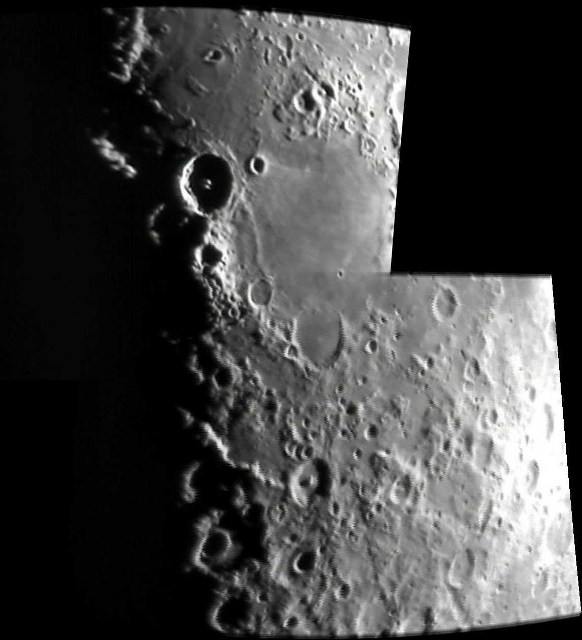 """The Moon composite image, by Charlie Jordan, imaging date on or before 8th February 2011. Charlie says: Two photos stitched together. I used an 8"""" reflector with modified Samsung SDC-435 cctv camera plus 2x Barlow lens."""