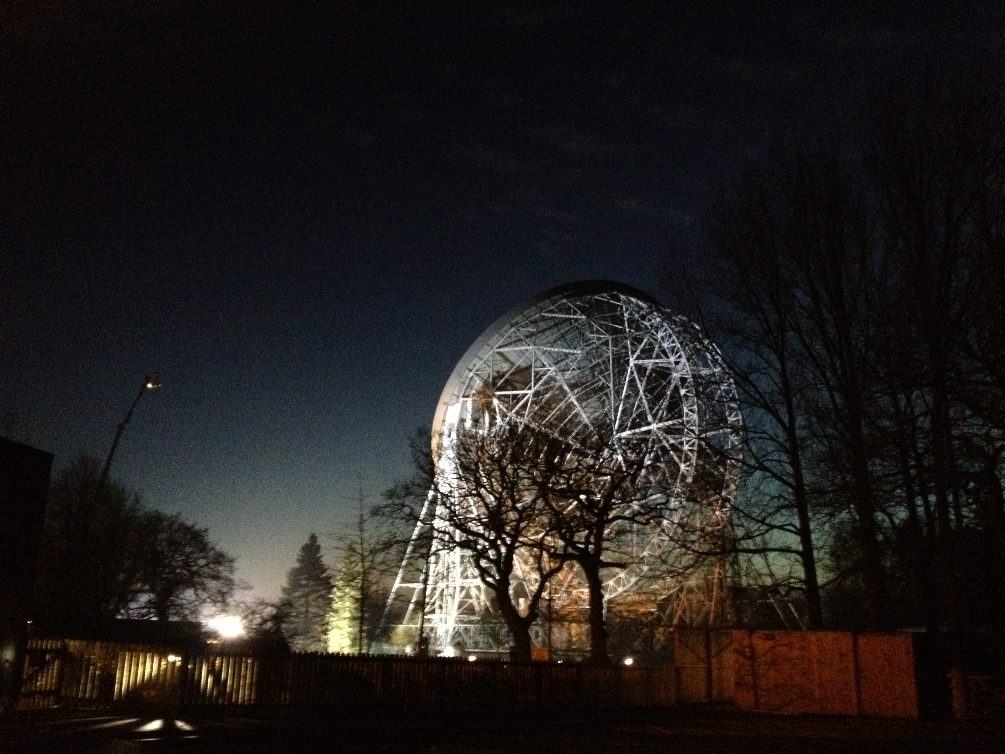 The Lovell Telescope (floodlit at night, facing away from the camera) at Jodrell Bank, at BBC Stargazing Live 2013, Wednesday 9th January 2013